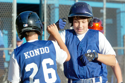 Saratoga American's Shane Barringer celebrates with teammate Nick Kondo after hitting a home run during their game against Saratoga National's 11-U little league Championship at East Side Rec Monday evening. Photo Erica Miller 7/26/10 spt_AmNat'l2_Tues
