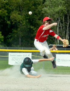 Wilton Rebels Marshall Kiesav leaps into the air after passing the ball to first base for two outs as Clifton Park Waldek slides out during their 12-U game at Gavin Park Sunday afternoon. Photo Erica Miller 7/18/10 spt_WiltonCP3_Mon