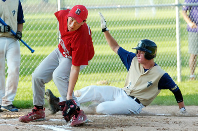 Adirondack Hawks Liam Kane slides safely into home plate as pitcher of Brunswick Buckeyes John Moak misses a pass during their 15U game at Gavin  Park Wednesday evening. Photo Erica Miller 7/21/10 spt_AdkBruns1_Thurs