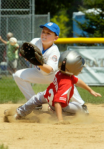 Wilton Rebel Max Jackson slides safely into second base as second baseman Anthony Passaro, Beekman, waits for a pass during their Cal Ripken Little League baseball game at Gavin Park Saturday morning. Photo Erica Miller 7/17/10 spt_WiltBeek2_Sun