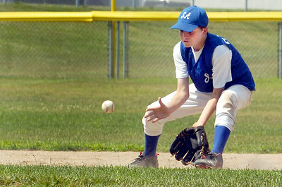 Saratoga Americans Rory Flaherty catches a ground ball to pass to first base during their District 11 Little League Championship Saturday afternoon at West Side Rec against Hudson Falls. Photo Erica Miller 7/17/10 spt_SarAmHuds4_Sun