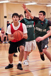 Max Glansberg gets ready to put the ball up while Ben Miller of Stewies Team moves in to block Sunday Morning at the YMCA in Saratoga. Photo Eric Jenks 12/13/09