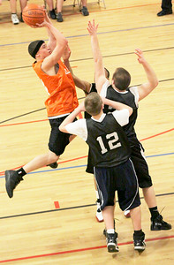 Devin Wicks of Allerdice sails through the air for two over the defense of Appraisal Company at Saratoga YMCA. Photo Wendy Voorhis spt_YMCAball8