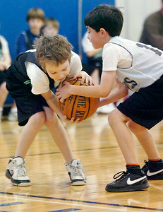 Quinn Jones, Celtics, and Charlie Beck, Timberwolves, battle for the ball during their Jr NBA Championships game at Gavin Park Saturday morning. Photo Erica Miller 2/6/10 wg_JrNBA2
