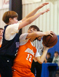 Joseph LoPresti, Bobcats, tries to take a shot at the basket blocked by Jack Gaba, Thunder, during their Division 2 basketball game Saturday morning at Gavin Park. Photo Erica Miller 12/19/09 wg_JrNBA9
