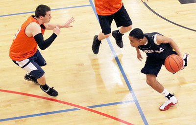 Perry Raynor, Appraisal Team, brings the ball up the court as Jack Burnell, Allerdice, shifts direction into defense mode Sunday afternoon at the Saratoga YMCA. Photo Wendy Voorhis spt_YMCAball5