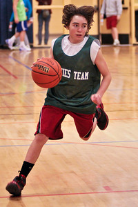 Matt Chichester of Stewie's Team drives the ball down the court during their game against D A Collins Sunday Morning at the Saratoga Springs YMCA. Photo Eric Jenks 12/13/09