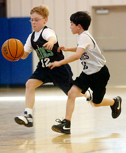 Charlie Liebers, Celtics, dribbles the ball down the court against Charlie Beck, Timberwolves, during their Jr NBA Championships game at Gavin Park Saturday morning. Photo Erica Miller 2/6/10 wg_JrNBA5