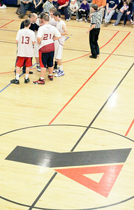 Springs Street Coach Anthony Gargano huddles with his team for a last minute winning play. Photo Wendy Voorhis spt_YMCA2ball4