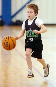 Quinn Jones, Celtics, dribbles the basketball down the court during their Division I game against the Timberwolves Saturday morning for the Jr NBA Championships. Photo Erica Miller 2/6/10 wg_JrNBA1