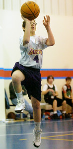 Caleb Ruhm, Lakers, takes a shot at the basket during their Division 3 basketball game against the Celtics Saturday morning at Gavin Park. Photo Erica Miller 12/19/09 wg_JrNBA3