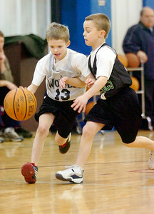 Charlie Beck, Timberwolves, dribbles the ball down the court against Celtics Corey Wurl during their Division 1 Junior NBA Championship Games at Gavin Park Saturday morning. Photo Erica Miller 2/6/10 spt_JrNBA1_Sun
