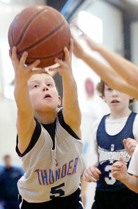 Matthew Myers, Thunder, grabs the ball after a re-bound during their Division II Junior NBA Championship Games against The Mavericks at Gavin Park Saturday morning. Photo Erica Miller 2/6/10 spt_JrNBA3_Sun
