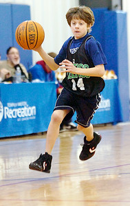 Will Fox, Celtics, carries the basketball down the court during their Division I game against the Timberwolves Saturday morning for the Jr NBA Championships. Photo Erica Miller 2/6/10 wg_JrNBA3
