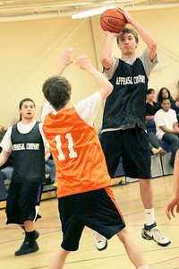 Conor Cohen of Appraisal Company takes a jump shot in the first minutes of Sunday's Division Finals at the Saratoga YMCA. Photo Wendy Voorhis spt_YMCAball1