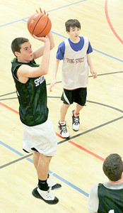 John Rach of Sports Design takes a jump shot for a two in Sunday's game against Spring Street at the Saratoga YMCA. Photo Wendy Voorhis spt_YMCA2ball5