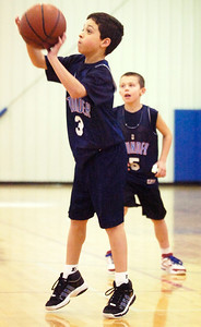 Connor Farrington, Thunder, takes a shot at the basket during their Division 2 basketball game against the Bobcats Saturday morning at Gavin Park. Photo Erica Miller 12/19/09 wg_JrNBA5