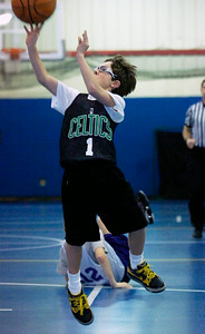 Matt Biasetti, Celtics, takes a shot at the basket during their Division 3 basketball game against the Lakers Saturday morning at Gavin Park. Photo Erica Miller 12/19/09 wg_JrNBA2