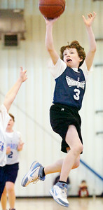 Connor Sullivan, Mavericks, takes a shot at the basket during their Division II Junior NBA Championship Games against The Thunders at Gavin Park Saturday morning. Photo Erica Miller 2/6/10 spt_JrNBA4_Sun