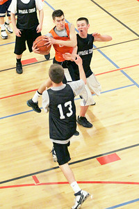 Gavin Cummings of Allerdices grabs the pass to go to the hoop in Sunday's game against Appraisal Company at Saratoga YMCA. Photo Wendy Voorhis spt_YMCAball7