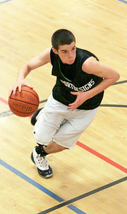 John Rach of Sports Design drives to the hoop in a close division final against Spring Street at the Saratoga YMCA. Photo Wendy Voorhis spt_YMCA2ball2