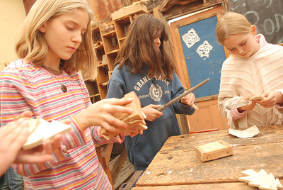 Waldorf School students (from left) Arielle Gitlin, Calayan Knight and Bianca Moser put the finishing touches on wooden Christmas tree ornaments  Thursday November 29, 2007 in Ukiah, Calif. (MacLeod Pappidas/The Ukiah Daily Journal).