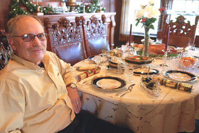 Marvin Schenck, curator of the Grace Hudson Museum, sits at an exhibit featuring a Christmas feast of cooked goose as it may have looked in the early twentieth century Thursday November 29, 2007 in Ukiah, Calif. (MacLeod Pappidas/The Ukiah Daily Journal).