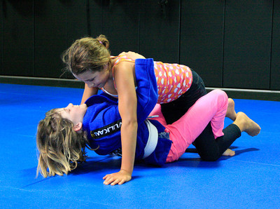 Shaun Walker/The Times-Standard  Haley Thomas, bottom, practices with Serenna Abrey, both 9, at a youth jiu jitsu session at North Coast Self Defense Academy in Arcata on Wednesday. The class teaches the basics of Brazilian jiu jitsu and the Gracie BullyProof system, which is designed to to instill unshakable confidence in children so they can overcome bullies without violence. They learn verbal assertiveness to deter bullies, several non-violent self-defense techniques to stay safe if physically assaulted, and not how to punch or kick.