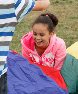 Shaun Walker/The Times-Standard  Jayda Alcutt, 8, and others play with a parachute during the Washington After School program in Eureka on Friday afternoon. Participants also played games with balls and other activities.