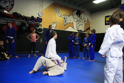Shaun Walker/The Times-Standard  Students practice techniques at a youth jiu jitsu session at North Coast Self Defense Academy in Arcata on Wednesday. The class teaches the basics of Brazilian jiu jitsu and the Gracie BullyProof system, which is designed to to instill unshakable confidence in children so they can overcome bullies without violence. They learn verbal assertiveness to deter bullies, several non-violent self-defense techniques to stay safe if physically assaulted, and not how to punch or kick.