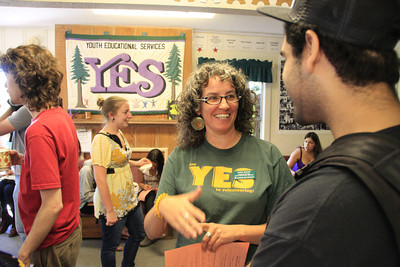 Shaun Walker/The Times-Standard  Youth Educational Services Coordinator Lorena Boswell, left, talks with student Rodrigo Avila at the Humbodlt State University group's open house on Wednesday. The mission of YES is to support HSU students in creating and implementing volunteer programs. Their student-run programs provide services to a broad age spectrum ranging from youth to the elderly. Volunteers spend time in the community building friendships and working together to meet community needs.