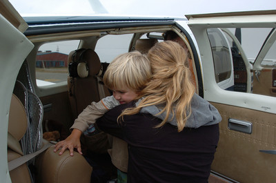 Mark McKenna/ The Times-Standard Cahaela Class hugs her brother Jessiah as he prepares to fly on an Angel Flight to Oakland International Airport.