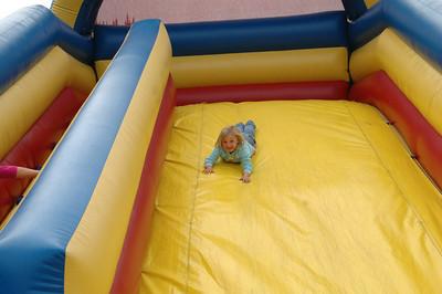Chloe Sample, 5, of McKinleyville, enjoys an inflatable jump slide at the McKinleyville Shopping Center on Saturday during the Azalea Festival.
