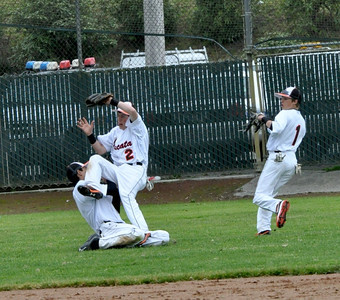 José Quezada/For the Times-Standard  ARC 2 holds on to the ball as he falls over sliding centerfielder