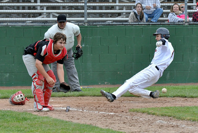 José Quezada/For the Times-Standard  ARC 4 slides into home ahead of the ball on ARC 1 RBI bottom of 8th