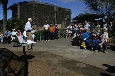 Josh Jackson/The Times-Standard  Sequoia Park Zoo Foundation President Jeff Lamoree shares a memory during an appreciation ceremony for Bill the Chimp at the chimp's former enclosure at the Sequoia Park Zoo on Sunday.