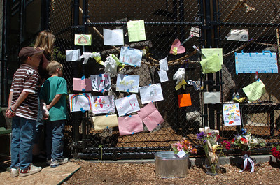 Mark McKenna/The Times-Standard Patty Callison and her two sons Blake, 7, and Connor, 9, of Eureka came to pay their respects to Bill the Chimp