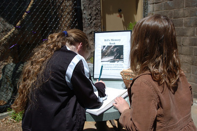 Mark McKenna/The Times-Standard Faith Long, 9, left and Maddi Dunlap, 5 signed the memory book left for Bill. The two also placed flowers outside of Bill's enclosure on Wednesday afternoon.