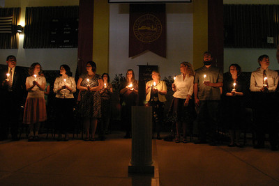Josh Jackson/The Times-Standard  Nursing graduates hold symbolic candles during the Registered Nursing Class of 2007 Pinning Ceremony at College of the Redwoods on Saturday.