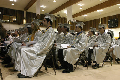 Josh Jackson/The Times-Standard  Graduates patiently await the presentation of diplomas  during  the College of the Redwoods commencement on Saturday.