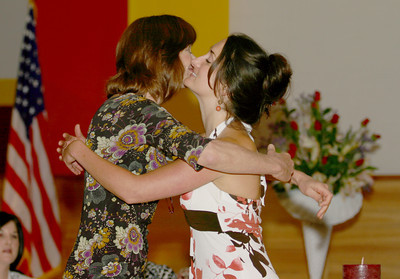 Josh Jackson/The Times-Standard  Kellye Egan gets a hug from her mother, Micki McCollister during the Registered Nursing Class of 2007 Pinning Ceremony at College of the Redwoods on Saturday.