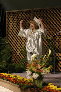 Josh Jackson/The Times-Standard  Lynn Wilson cheers before receiving her diploma during the College of the Redwoods commencement on Saturday.