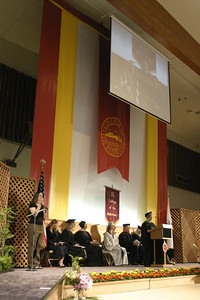 Josh Jackson/The Times-Standard  Academic Senate Copresident Carol Mathews delivers remarks during  the College of the Redwoods commencement on Saturday.