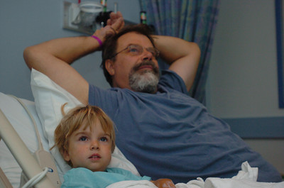 Mark McKenna/ The Times-Standard Doby Class and his son Jessiah watch television at UCSF Medical Center in San Francisco prior to a kidney transplant operation.