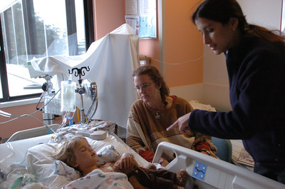 Mark McKenna/ The Times-Standard Pediatric Nephrologist Dr. Farzana Perwod, right, checks on Jessiah Class and his mother Kim following a kidney transplant in the Pediatric Intensive Care Unit at UCSF Medical Center in San Francisco.