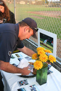 Erik Fraser/The Times-Standard Humboldt Crabs manager Matt Nutter puts out photos at the Crabs' celebration of the life of pitcher Kevin Morsching at the Arcata Ball Park on Saturday, Sept. 8, 2007. Morsching, who pitched in 19 games for the Crabs in 2007, died after a skateboarding accident in Rapid City, S.D. last month.