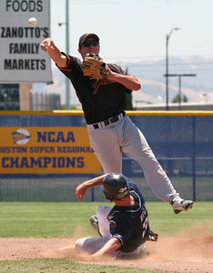Erik Fraser/The Times-Standard The Humboldt Crabs' Denis Hill breaks up a potential double play by sliding into Bay Area Giants second baseman Dallas Howell in the Best of the West Tournament at Santa Jose State University on Friday, June 22, 2007.