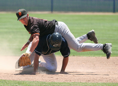 Erik Fraser/The Times-Standard The Humboldt Crabs' Denis Hill is safe at second and has Bay Area Giants shortsto Ryan Silver land on him during the Best of the West Tournament at Santa Jose State University on Friday, June 22, 2007.