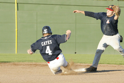 Josh Jackson/The Times-Standard  Crabs' Richard Cates slides into second as Ratz' #4 waits for the late throw during Monday's game in Arcata.