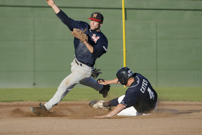 Josh Jackson/The Times-Standard  Crabs' Richard Cates slides into second as Ratz's #4 misses the tag during Monday's game in Arcata.